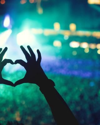 Hands forming a Heart at Music Event