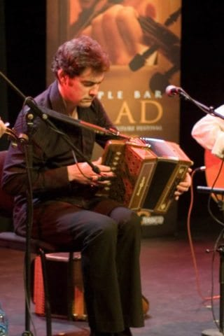Musicians Playing Traditional Irish Music on Stage